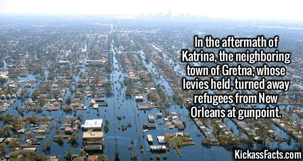 2225 Katrina Aftermath-In the aftermath of Katrina, the neighboring town of Gretna, whose levies held, turned away refugees from New Orleans at gunpoint.
