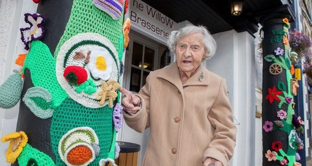 """Grace Brett who is 104 and possibly the countries oldest street artist. Women from Selkirk, Ettrickbridge and Yarrow, in the Scottish Borders who are a team of """"guerrilla knitters"""" have decorated local landmarks with crochet and knitted art. See Centre Press story CPKNIT. A 104 year old knitter who has Ãyarn bombedà her local town is thought to be the world's oldest street artist. Grace Brett is a member of a secret band of guerilla knitters, who have bedecked their town in artful knitting. Called the Souter Stormers, the group hit various landmarks in Selkirk, Borders, with their yarn work last week, following hours of preparation.  Members of the yarn bombing team are mainly over 60, but Grace à the oldest à has lived over a century."""