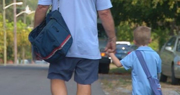 4. Little Boy Idolizes 'Mailman Mike' Who Takes Him On Daily Rounds