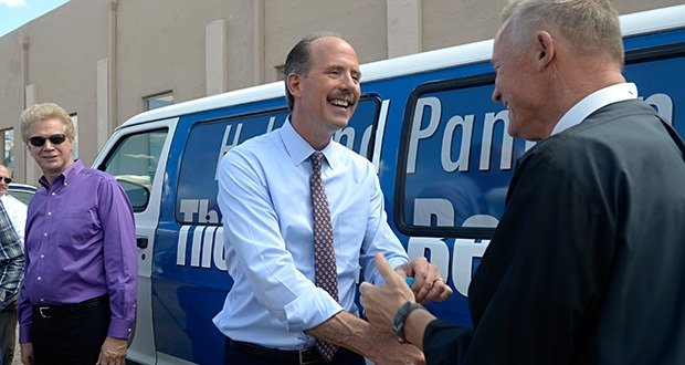 """dh083115d/a-sec-metro/08312015---Albuquerque Mayor Richard J. Berry presents the keys to the """"There's a Better Way"""" van to Father Rusty Smith  Executive Director of St. Martin's Hospitality Center. The van will cruise the streets of the city manned by personnel from St. Martin's Hospitality Center offering panhandlers work, photographed on Monday August 31, 2015. Randy Woodcock Vice President of the United Way of Central New Mexico is left. (Dean Hanson/Albuquerque Journal)"""