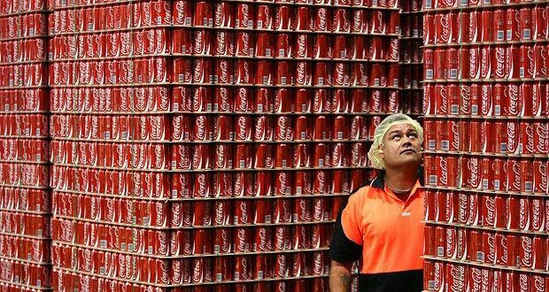 An employee inspects skids of Coca-Cola soft-drink ready for dispatch from the Coca-Cola Amatil Ltd. bottling plant in Sydney, Australia, on Thursday, April 30, 2009. Coca- Cola Amatil Ltd. is Australia's biggest soft-drink maker. Photographer: Ian Waldie/Bloomberg News