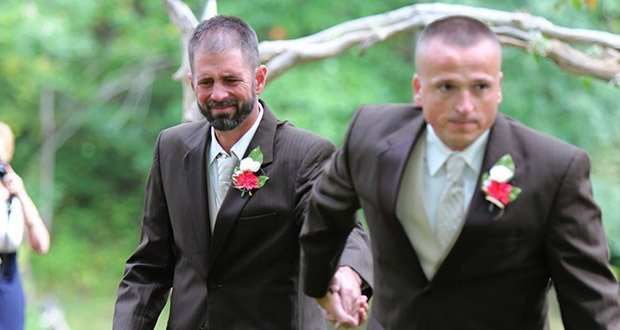 10. Father brings his daughter's stepdad up the aisle