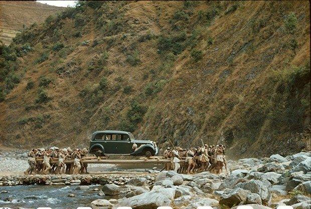 Nepali men carrying the 1938 Mercedes Benz