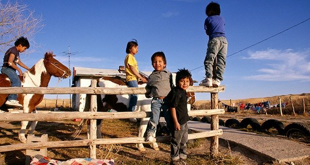Pine Ridge Sioux Indian Reservation, South Dakota, Oglala Sioux (Lakota) brothers play at rural home in Kyle area