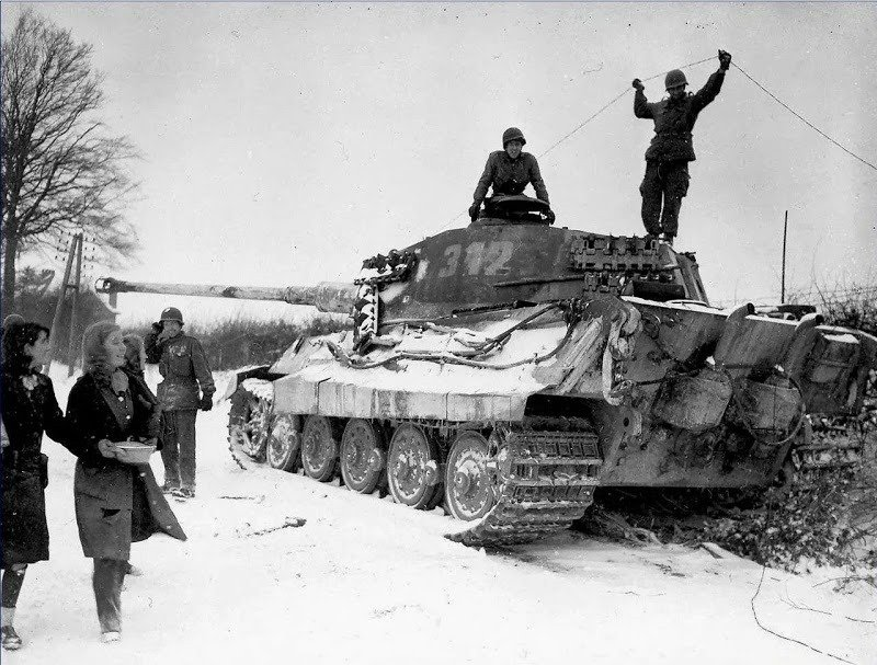 25. Inspecting a Destroyed Tank
