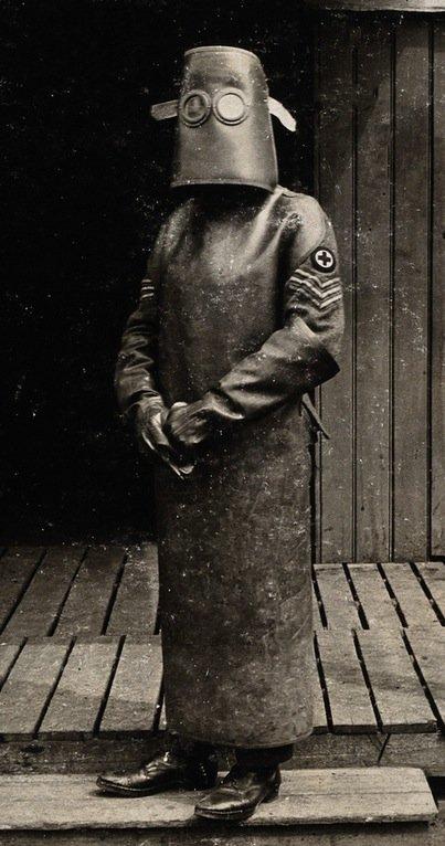 Radiographer wearing a hazmat suit