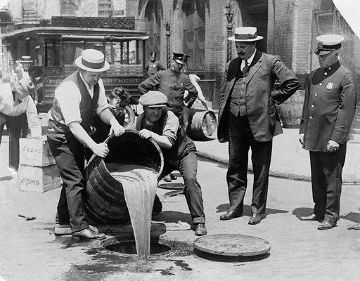 agents pouring out liquor