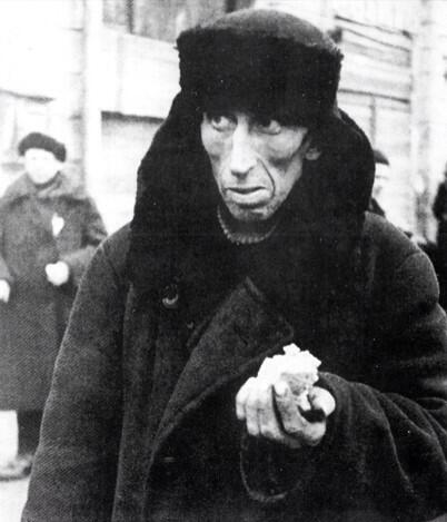 A man holding his daily ration of food Siege of Leningrad