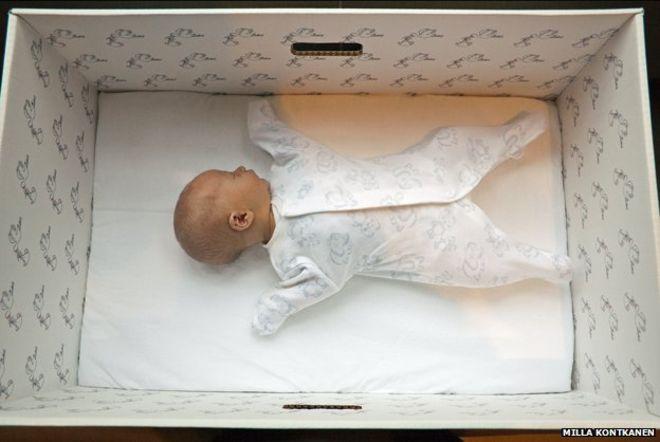 Finnish baby sleeping in cardboard