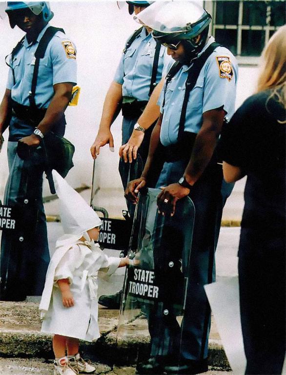 white-child-touches-the-shield