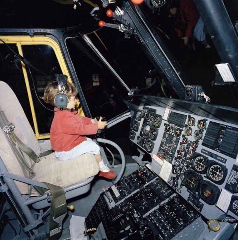 JKF Jr playing at the controls