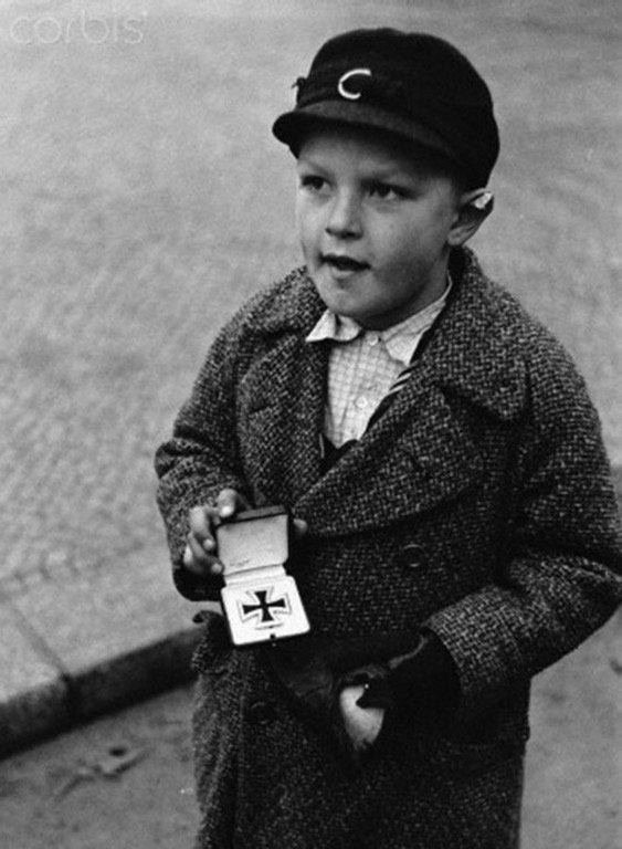 german-boy-seliing-iron-cross